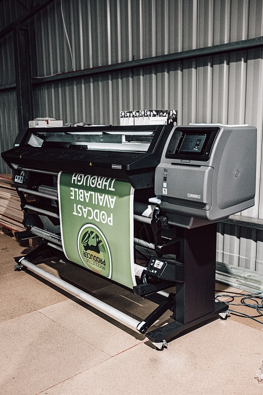 Luxus Banner being printed in house.